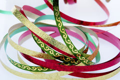 Red, Gold and Green Ribbon up Close Royalty Free Stock Images