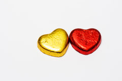Red and gold heart chocolate candy isolate on white background Royalty Free Stock Photos