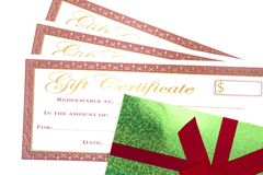 Red and Gold Holiday Gift Certificates. On a White Background royalty free stock image