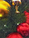 Red and gold holiday ornaments. Christmas light season celebration merry pine garland stock photography