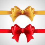 Red and gold holiday ribbon with bow Stock Photo