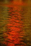 red and gold lights on water, Las Vegas Stock Photo