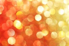 Red, gold, orange sparkle background. Soft lights, Christmas background stock images