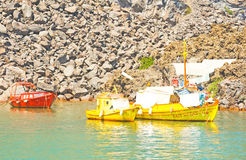 Red and gold painted fishing boats. Royalty Free Stock Images