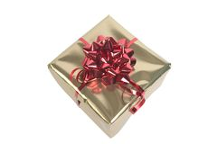 Red  & Gold parcel. Red bow & Ribbon on Gold mettalic paper Stock Photo