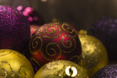 Red gold and purple christmas tree balls Royalty Free Stock Images
