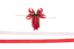 Red&Gold ribbon and bow isolated on white background Royalty Free Stock Images