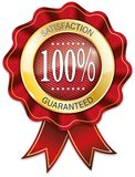 Red and gold 100% satisfaction guaranteed ribbon badge. ROUND RED GOLD RIBBON ON WHITE BACKGROUND Stock Photography