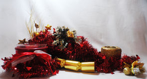 Red and gold setting. Red tinsel, gold candle, gold cracker( bon bon), red candle and garland Stock Photos