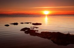 Red-Gold Sunset. Sunset over bay beach, Melbourne, Australia royalty free stock photo