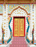 Red And Gold Thai Church Entrance With Green Serpent Royalty Free Stock Images