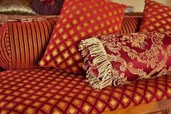 Red gold velvet pillows Stock Images