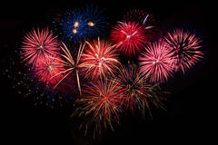 Red golden blue fireworks over night sky Stock Image