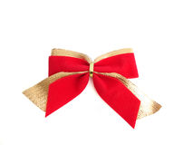 Red-golden bow on a white background. Red and golden bow on a white background Stock Photography