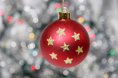 Red golden christmas ball against silvery background Stock Images