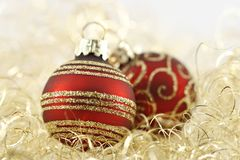 Red and golden christmas balls. On golden wool Stock Photography