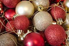 Red and golden christmas balls. On pile royalty free stock images