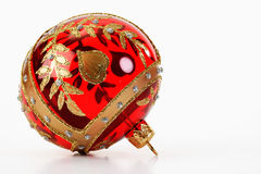 Red and golden Christmas bauble on white background Stock Photo