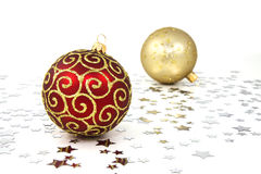 Red And Golden Christmas Baubles. One red and one golden christmas tree baubles with silver stars on white Stock Images