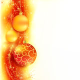Red golden Christmas border with Christmas balls. Border with red and golden Christmas balls hanging over a red, golden wavy pattern with stars and snow flakes Royalty Free Stock Image