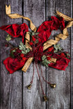 Red, golden Christmas decor with bow and bells Royalty Free Stock Images