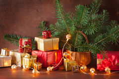 Red and golden christmas gift box and decoration lantern candle Stock Photos