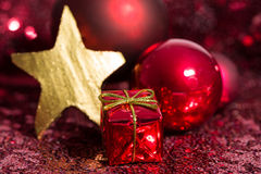 Red and golden Christmas ornaments with bokeh background Stock Photos