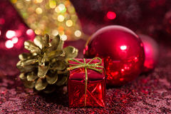 Red and golden Christmas ornaments with bokeh background Royalty Free Stock Photography