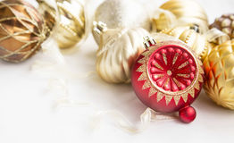 Red and golden Christmas ornaments with glitter globes and ribbo Stock Photos