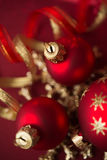Red and golden christmas ornaments on red background. Red and golden christmas ornaments on red xmas background Stock Image