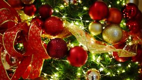 Red and golden christmas tree ornaments stock video