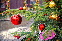 Red and golden decorating balls on the christmas tree. At the street market royalty free stock photos