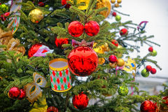 Red and golden decorating balls on the christmas tree. At the street market stock photos