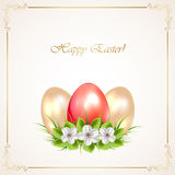 Red and golden Easter eggs with flowers Royalty Free Stock Image