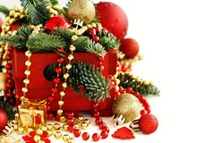 Red and golden festive christmas decorations. Isolated on white Royalty Free Stock Images