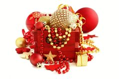 Red and golden festive christmas decorations. Isolated on white Royalty Free Stock Image