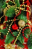 Red and golden festive christmas decorations. Isolated on white Royalty Free Stock Photography