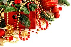 Red and golden festive christmas decorations. Isolated on white Stock Photos