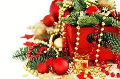 Red and golden festive christmas decorations. Isolated on white Royalty Free Stock Photo