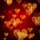 Red golden hearts background. Red and golden hearts over red background with feather center Royalty Free Stock Photo