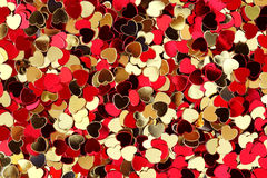 Red and golden hearts confetti Royalty Free Stock Photo