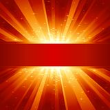 Red golden light burst with stars and copyspace Stock Images