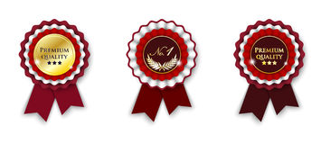 Red and golden ribbon rosette Stock Photos