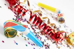 Red and golden ribbons and small confetti colorful Stock Images