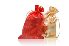Red and golden sacks over white Stock Image