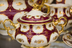 Red and golden tableware Royalty Free Stock Images