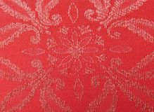 Red golden textile pattern. Textile in old flower pattern red and golden Royalty Free Stock Images