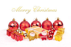 Red and golden xmas ornaments. Red and gold xmas ornaments and golden text Stock Images