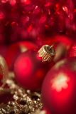 Red and golden xmas ornaments on bright bokeh background. Holiday theme Stock Image