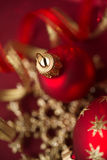 Red and golden xmas ornaments on bright bokeh background Stock Photos